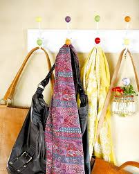 hooks is the most traditional way to store several scarves in a hallway