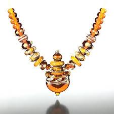 vps 120 amber lampwork vessel pendant set