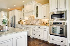 fascinating kitchens with white cabinets. Fascinating Kitchen Elegant Backsplash White Cabinets Dark Floors Pics Of Trend And Tiles Kitchens With I