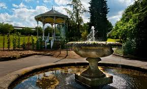 the grounds of the birmingham botanical gardens a fountain and a bandstand are pictured