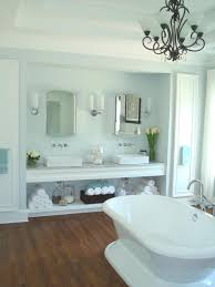 white bathroom vanities ideas. Place White Bathtub Under Classic Chandelier Inside Contemporary Bathroom With Clean Vanity Ideas Vanities F