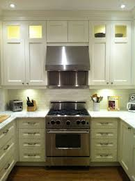 kitchen lighting kitchen above cabinet lighting with stainless steel range hood vent also wooden knife block above cabinet lighting