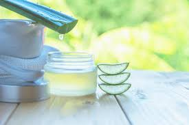 aloe vera for acne juice of plants being poured into cosmetics jar outdoors