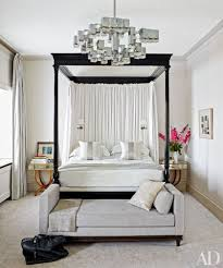 in the master bedroom of a london rowhouse updated by veere grenney a 1970s gaetano sciolari light fixture from galerie yves gastou joins a veere grenney