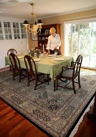 an expansive handmade oriental rug covers the dining room floor in jim and susie smith s home in davis the rugs in the smith home are laid out with the