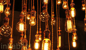 urban chandy s recycled chandeliers use vintage edison bulbs with cool coils