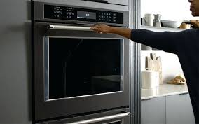self clean in oven person closing a self cleaning oven clean smeg oven door glass clean