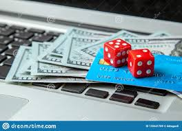 Online Casino, Online Gambling. Money Cash Dollars And Credit Brief With  Dice For Gaming On Laptop Keyboard. Stock Image - Image of addiction,  business: 133441705