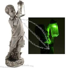 boy with solar lighted firefly jar garden statue loading zoom