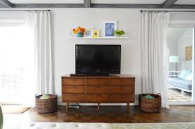 a easy shelf for that blank spot over the tv wall mounted cabinet to hide tv diy cabinet to hide tv