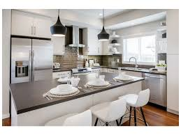 Bar Stools Contrast Two Toned Cabinetry Pendant Lights Glam ...