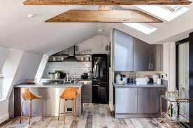 View in gallery Attic kitchen with skylights and tiled backsplash [Design:  Barlow & Barlow Design]