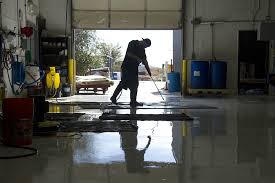 workers clean rugs on a saturated floor at the robert mann oriental rugs building kevin j beaty denverite