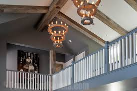 a vaulted ceiling design is easily enhanced with reclaimed beams