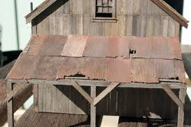 in the case of my faulks oil co structure i wanted a roof that was starting to show signs of weathering and neglect but was still serviceable