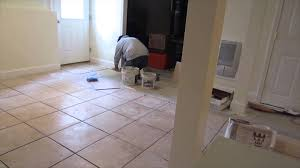 time lapse of a 16 x16 ceramic tile installation on a basement concrete floor you