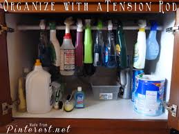 Under Kitchen Sink Organizing Organize With A Tension Rod Made From Pinterest