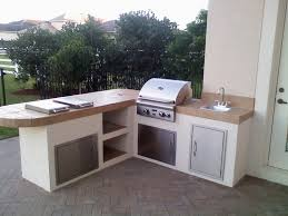 custom outdoor kitchen grill island with built in grill and two side with outdoor kitchen grills