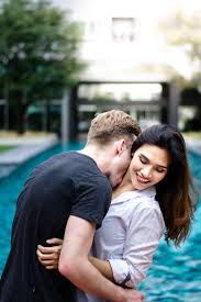 affection blurred background couple daytime embracing expression happy interaction kissing love man outdoors people