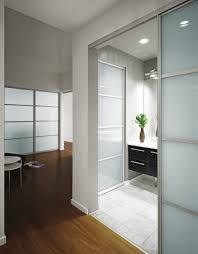 living room frosted glass sliding door as room dividers brown wooden laminate open flooring for