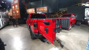 Ram 1500's new tailgate folds and swings for access with or without ...