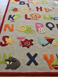 kinderloom alphabet rug rosenberryroomscom