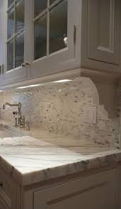 use corbels to create interest the light rail helps hide the under cabinet lighting and adds