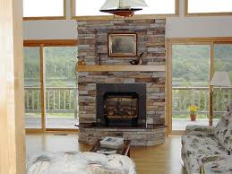 interesting dry stack stone fireplace with shelf under square painting