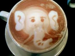 This is an elephant design in a latte cappuccino