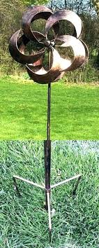 feather kinetic wind spinner metal garden art brings mesmerizing movement to your lawn spinners