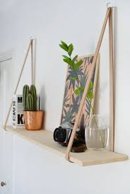 DIY: hanging leather shelf (with command hooks for Matt's bathroom stuff,  my bedside table