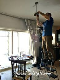 ballard chandelier have a strong person handy to pull apart the chains and shorten to desired