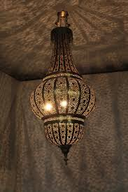 moroccan chandeliers lighting fixtures with lamp pendant light that will transform your and 11 themed party als chandelier silver 02fb0ec0ffeb3d8f small