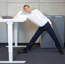 whether you sit or stand at work experts recommend stretching or taking short walks during