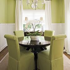 small dining room chairs. Furniture : Small Dining Room With Round Black Table Feat Green Chairs Covers Under White Modern Chandelier Close To Fabric Curtain N