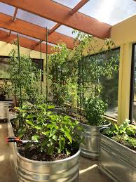 this is because standard greenhouse materials like glass and plastic glazing are extremely good at letting in light and heat in and extremely good