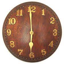 arts crafts oak and brass wall clock