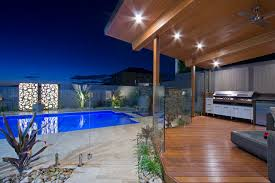 design ideas for a mid sized modern backyard deck in brisbane with an outdoor kitchen