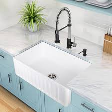farmhouse sink with stone countertop
