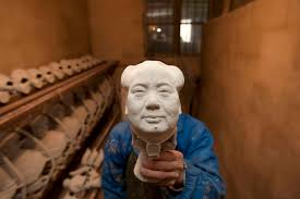 a worker makes a bronze statue of s late chairman mao zedong a worker makes a bronze statue of s late chairman mao zedong at a factory in shaoshan