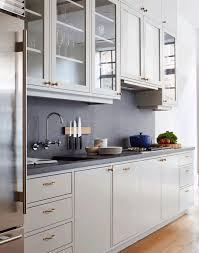 Kitchen: Clear Glass And White Frame Doors Of Hangin Cabinet_plain Grey  Backsplash_oak Paequete Flooring_dark Grey