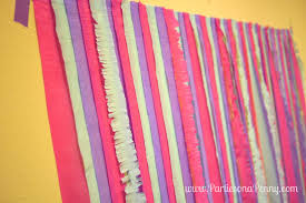 here is a quick and easy diy streamer backdrop you can put together costing only 5 for a photobooth or dessert buffet table display