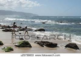 Woman With Her Daughter Enjoying On The Beach Laniakea Beach Haleiwa North Shore Oahu Hawaii Usa Stock Image