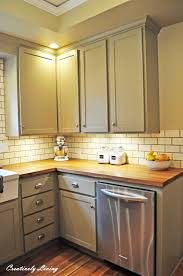 butcher block counter top with pretty lights and grey cabinet for kitchen decoration ideas