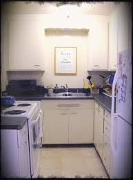 admirable decorating ideas using black granite countertops and l shaped cream wooden cabinets also with rectangle