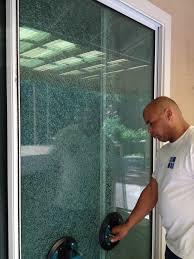 paul removing a shattered sliding glass door panel