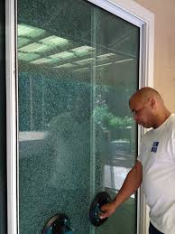 paul removing a shattered sliding glass door panel