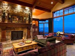 have stone from outside to match on fp front and sides wood stains large mantle with round pillars on bottom indent area for tv above mantle