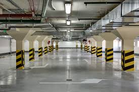 a clean parking lot has hazard paint and corner protectors on structural pillars