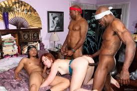 Shaved Black Jodi Taylor Enjoying Double Penetration Image.